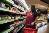 Woman at supermarket - 161963034