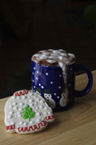 Ugly Sweater Christmas cookie with mug of Hot Chocolate