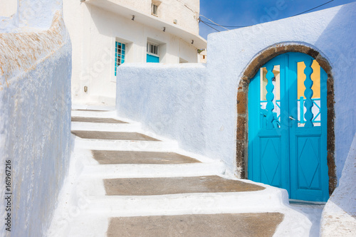 Narrow neighborhood at the old traditional village of Pyrgos, Santorini, Greece Poster