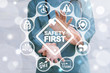 Leinwanddruck Bild - Work Safety Concept - regulations and standard in medical hospital. Doctor offers safety first sign on virtual screen. First secure rules.