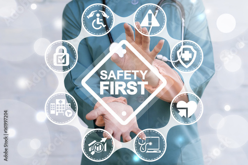 Leinwanddruck Bild Work Safety Concept - regulations and standard in medical hospital. Doctor offers safety first sign on virtual screen. First secure rules.