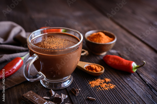 Foto op Canvas Hot chili peppers Hot chocolate with red chili pepper