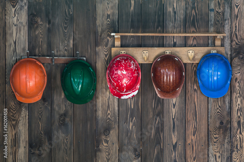 Multi-colored work helmets, construction helmets Poster