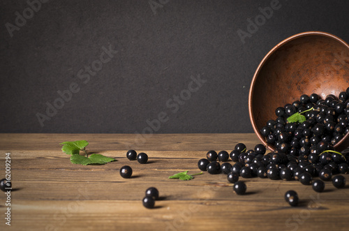 Black currant on a wooden background - 162009294