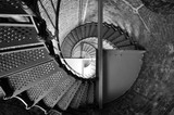 B&W View Looking Up Through Spiral Stair Case In Brick Tower