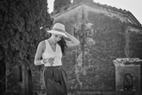 BW photography of a beautiful tourist woman. Italian holiday concept - 162036263