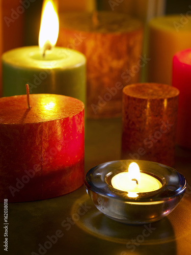 Fotobehang Zen Assorted colours candles and tea light candles