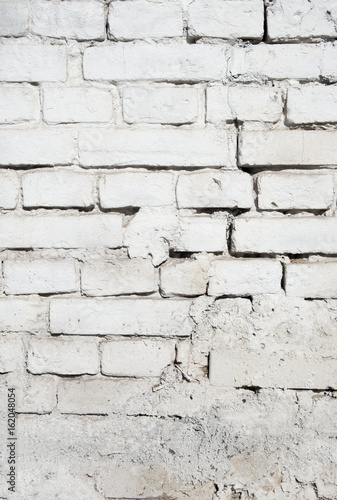 old brick wall texture background with worn off paint