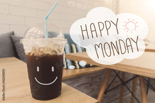 Happy Monday ice coffee drink in coffee shop background with vintage filter