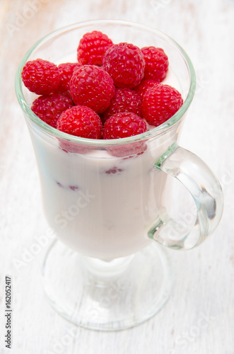 Healthy breakfast with yogurt and berry, selective focus
