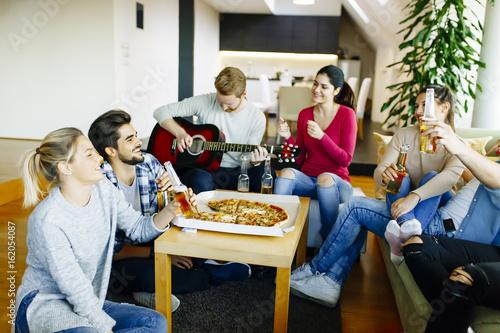 Fotobehang Muziek Group of young people having a party