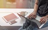 Digital lifestyle blog writer or business freelancer person using smart device working on internet communication technology  - 162054400