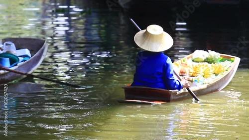 woman sailing wood boat in dumneon saduak ratchaburi thailand © stockphoto mania