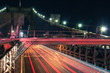 Traffic on the Brooklyn bridge at night, viewed from above. Strong diagonal lines