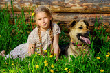 child with her sheepdog