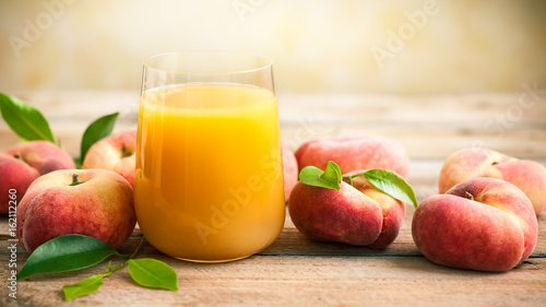 Fresh peaches juice in glass