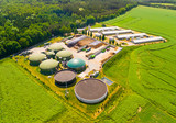 Aerial view over biogas plant and farm in green fields. Renewable energy from biomass. Modern agriculture in Czech Republic and European Union.  - 162162835