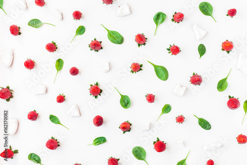Foto op Aluminium Milkshake Fresh strawberry and coconut on white background. Fruit pattern. Summer concept. Flat lay, top view