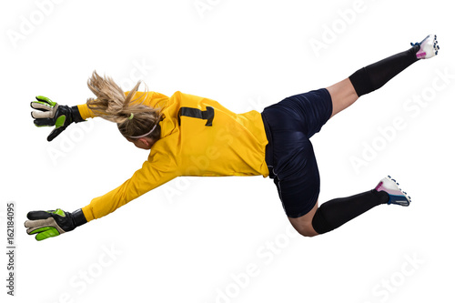 Fotobehang Voetbal female goakeeper jumping for the ball isolated on white background
