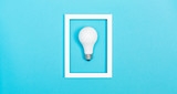 Fototapety Colored light bulb on vivid colored background