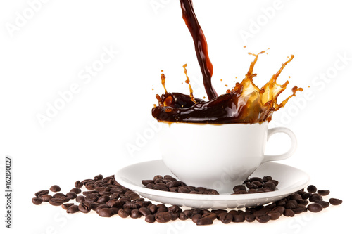 Pouring coffee into coffee cup with splashing., Isolated on white background. © Theeradech Sanin