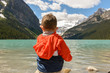Little boy admiring the view at Lake Louise in Summer