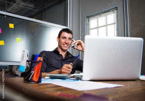 Business people use smatphone and computer laptop.