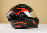 Fototapety Beautiful black with red motorcycle helmet. With a transparent visor. Closeup. Isolated