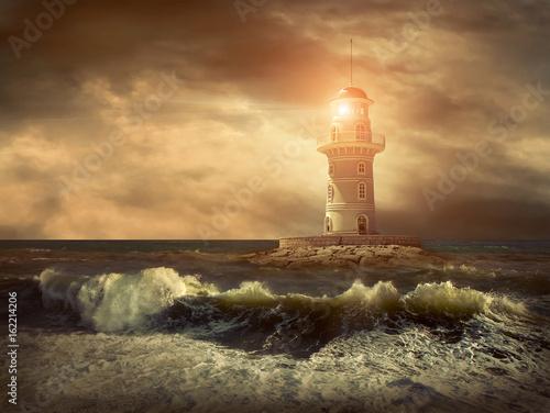 Lighthouse on the sea under sky