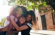 Group of female friends enjoying outdoors on city street