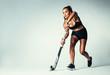 Female hockey player dribbling ball