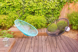 Two garden chairs in a small modern urban patio - 162235808