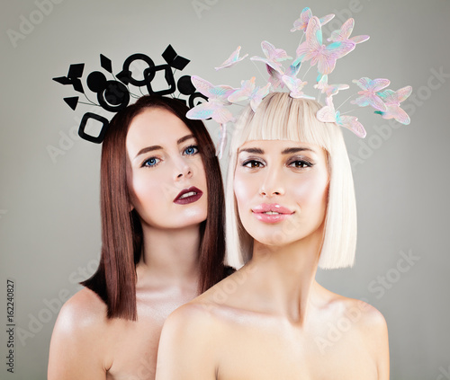 Two Beautiful Women Fashion Models with Fashion Hairstyle, Makeup and Hair Decorations