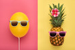 Fashion Pineapple and Pink air Balloon. Bright Summer Color, Accessories. Tropical Hipster pineapple with Sunglasses. Creative Art concept. Minimal style. Summer party background. Fun