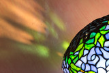 Tiffany style lamp and reflections. Diagonal close up. - 162253801