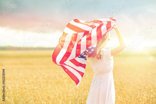 Poster happy woman with american flag on cereal field