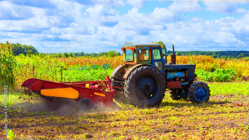 small tractor working in the field. smallholder agriculture