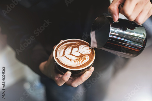 Barista make coffee cup latte art