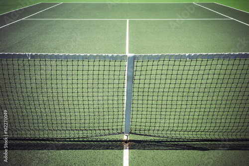 View down centre of tennis court on all weather surface