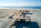 WILDWOOD, NEW JERSEY, USA - June 25, 2017: Crest beach and wooden dock from above with the ocean view and tourists relaxing - 162285249