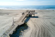Wildwood Crest beach and wooden dock from above with the ocean view and tourists relaxing