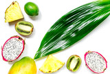 Set of exotic fruits. Dragonfruit, pineapple, mango, lime and kiwi on white background top view - 162285837