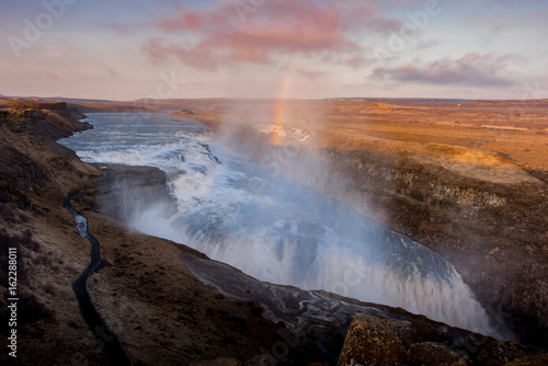 Gullfoss waterfall in Iceland Sunset with Rainbow and cloudy day - 162288011