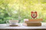 Cup of coffee white book and alarm clock on a Desktop from wooden plank. - 162306204