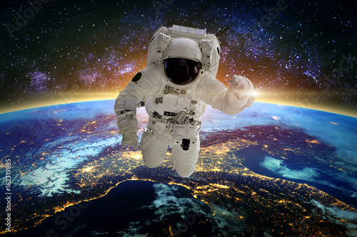 Astronaut in galaxy. Elements of this image furnished by NASA.