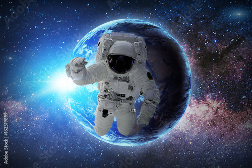 In de dag Nasa Astronaut in galaxy. Elements of this image furnished by NASA.