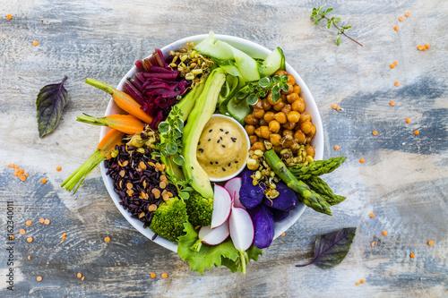 Foto Murales Buddha bowl, healthy and balanced food.