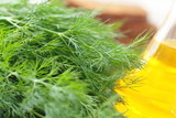 Bunch of ripe dill, bottle of oil and rye bread - 162344831