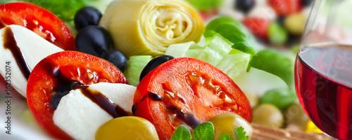 Fototapeta Wine and mozzarella - Italian dinner