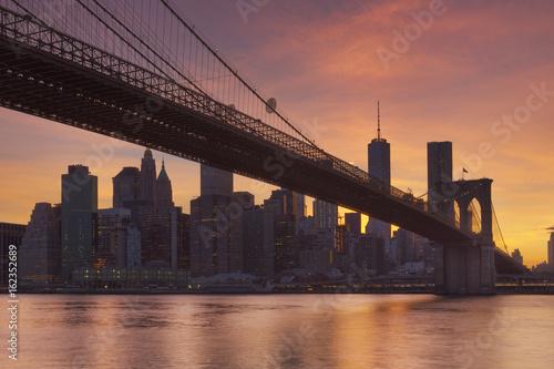 Brooklyn Bridge and New York City skyline at sunset Poster